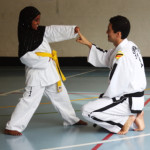 Senior Master Andrew K H Rhee teaching an 8th Kup