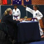 Lauren answering her terminology questions at her Grading to 2nd Kup, Red Belt
